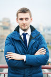 Portrait of a young businessman in a blue coat Stock Image