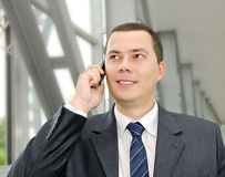 Portrait of young  businessman calling by telephone Royalty Free Stock Photo
