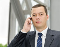 Portrait of young  businessman calling by telephone Stock Photos