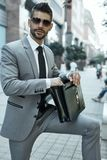 Portrait of young businessman on city street Stock Images