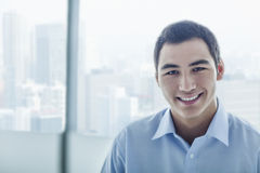 Portrait of young businessman with cityscape behind him royalty free stock photos