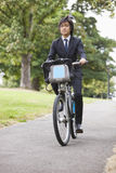 Portrait of young businessman commuting by his bicycle Royalty Free Stock Photos
