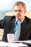 Portrait of a young businessman in doubt about som. Ething stock photography