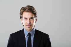 Portrait of a young businessman on grey background Stock Image