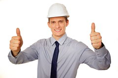 Portrait of young businessman in a helmet. Royalty Free Stock Photos