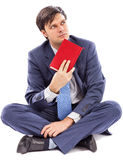 Portrait of a young businessman holding a book Royalty Free Stock Image