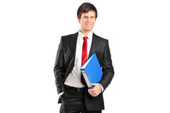 Portrait of a young businessman holding documents Stock Images