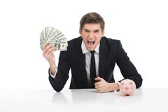 Portrait of young businessman holding dollars. Stock Images