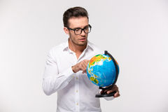 Portrait of a young businessman holding globe stock photos