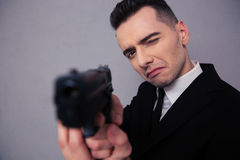 Portrait of a young businessman holding gun Royalty Free Stock Image