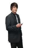 Portrait of a young businessman holding a mobile p Royalty Free Stock Image