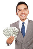 Portrait of a young businessman holding money Stock Photos