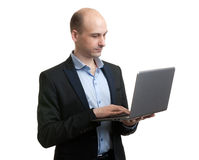 Portrait of young businessman with laptop Stock Photos