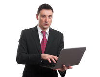 Portrait of young businessman with laptop Stock Images
