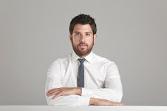 Portrait of a young businessman looking at camera. Royalty Free Stock Images