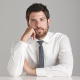 Portrait of a young businessman looking at camera. Royalty Free Stock Photography