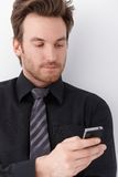 Portrait of young businessman with mobile Royalty Free Stock Photos