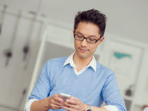 Portrait of young businessman with mobile Stock Photos