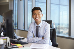Portrait Of Young Businessman At Office Desk Using Computer Royalty Free Stock Photo