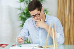 Portrait young businessman in office. Portrait young businessman in his office Royalty Free Stock Image