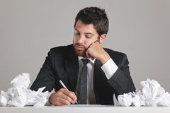 Portrait of a young businessman with papers around. Stock Image