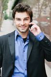 Portrait of a young businessman on the phone. Standing outside the office Stock Image