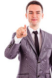 Portrait of a young businessman pointing with his finger Royalty Free Stock Photos