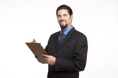 Portrait of a young businessman posing with a clipboard Royalty Free Stock Photo
