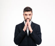 Portrait of a young businessman praying Stock Images