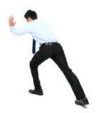 Portrait of young businessman pushing a blank board. On white background Royalty Free Stock Photo