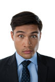 Portrait of young businessman with raised eyebrows Royalty Free Stock Photos