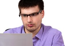 Portrait of young businessman, reading business document royalty free stock photos
