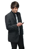 Portrait of a young businessman reading a message Royalty Free Stock Photography