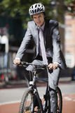 Portrait of young businessman riding bicycle Stock Photography