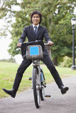 Portrait of young businessman riding bicycle with apart Royalty Free Stock Photography