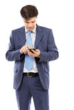Portrait of a young businessman sending text messages Royalty Free Stock Photo