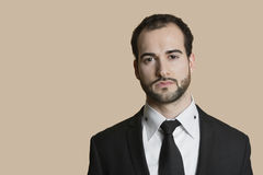 Portrait of young businessman with short hair and beard over colored background Stock Photo