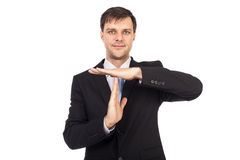 Portrait of young businessman showing time out sign with hands Stock Images