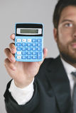 Portrait of a young businessman showing a zero on calculator. Stock Image