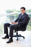 Portrait of a young businessman sitting on an armchair  Stock Photography