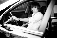 Portrait of young businessman sitting in luxury car Royalty Free Stock Photo
