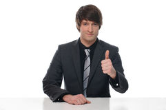 Portrait of a young businessman sitting with thumb Royalty Free Stock Photography