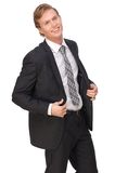 Young Businessman Smiling in Black Suit. Portrait of a young businessman smiling in black suit Stock Photos