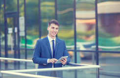 Portrait of a young businessman standing over Royalty Free Stock Photo
