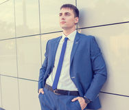 Portrait of a young businessman standing over Royalty Free Stock Images