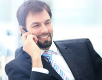 Portrait of a young businessman talking on the phone Royalty Free Stock Photo
