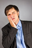 Portrait of a young businessman with toothache Stock Image