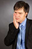 Portrait of a young businessman with toothache Royalty Free Stock Image