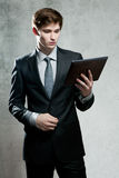 Portrait of young businessman with touch screen computer Royalty Free Stock Photos
