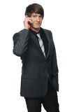 Portrait of a young businessman using mobile phone Stock Photography